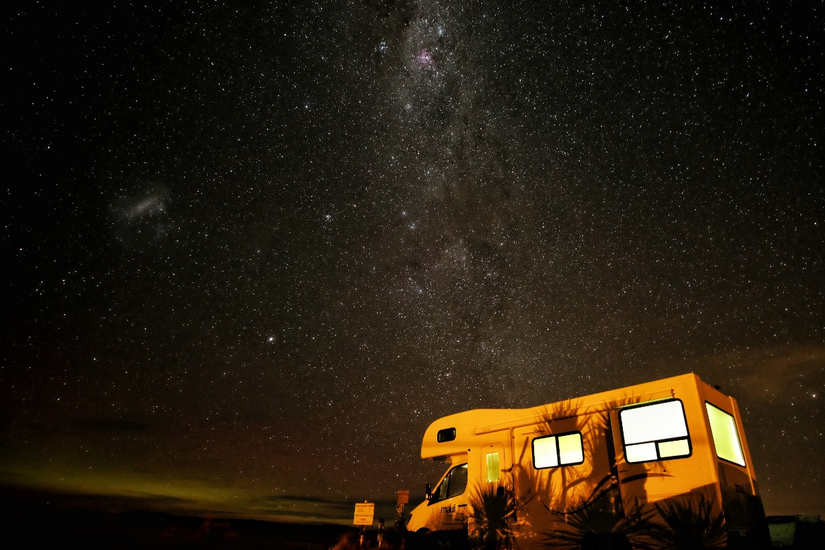 Photo of a Family Enjoying Some Good, Old-Fashioned Grand Canyon RV Camping Under the Stars.